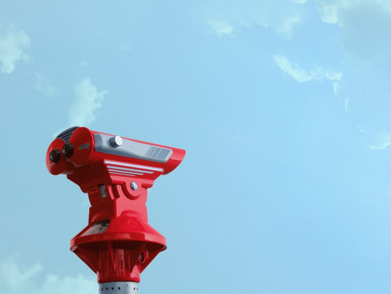 Binoculars pointing at the blue sky